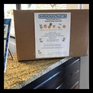 A food drive donation box in our office