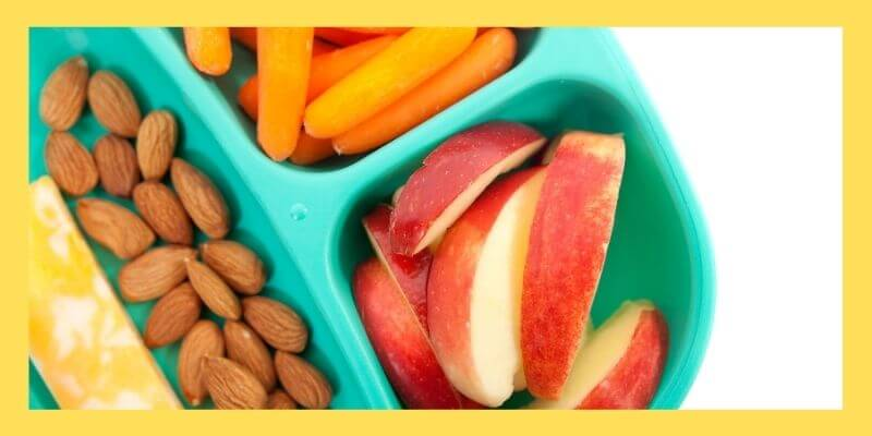 Snack tray with apple slices, carrots, almonds, and cheese.