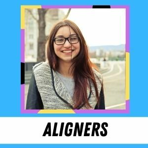 A teen smiles at the camera. The label says: Aligners