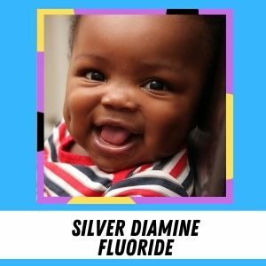 A toddler boy with dimples smiles. The label says: Silver Diamine Fluoride