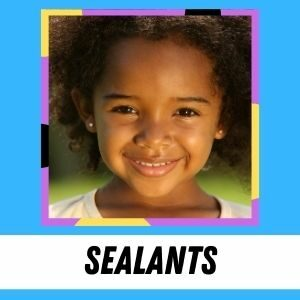 A young girl smiles at the camera. The label says: Sealants.