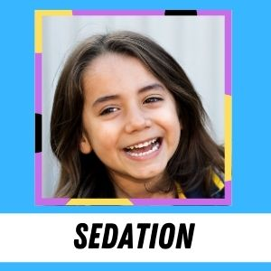 A young child smiles and laughs. The label says: Sedation